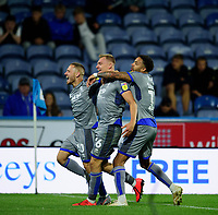 Lincoln City's Harry Anderson, (26), celebrates scoring the opening goal with team-mates Jack Payne, left, and Bruno Andrade<br /> <br /> Photographer Andrew Vaughan/CameraSport<br /> <br /> The Carabao Cup First Round - Huddersfield Town v Lincoln City - Tuesday 13th August 2019 - John Smith's Stadium - Huddersfield<br />  <br /> World Copyright © 2019 CameraSport. All rights reserved. 43 Linden Ave. Countesthorpe. Leicester. England. LE8 5PG - Tel: +44 (0) 116 277 4147 - admin@camerasport.com - www.camerasport.com