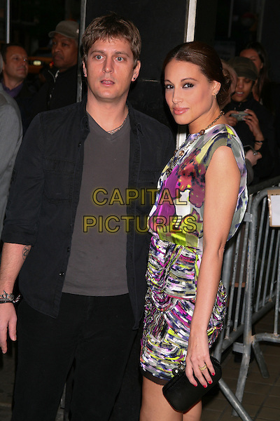 "ROB & MARISOL THOMAS.The Premiere of ""Solitary Man"" at Cinema 2, New York, NY, USA..May 11th, 2010.half length sleeveless dress pink purple green  black clutch bag pattern print married husband wife black suit grey gray top.CAP/LNC/TOM.©TOM/LNC/Capital Pictures."
