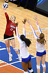 KANSAS CITY, MO - DECEMBER 16: Annika Albrecht (17) of the University of Nebraska reaches to spike the ball during the Division I Women's Volleyball Championship held at Sprint Center on December 16, 2017 in Kansas City, Missouri. (Photo by Jamie Schwaberow/NCAA Photos via Getty Images)