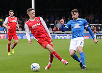 Peterborough United's Michael Smith plays the ball past Fleetwood Town's Ashley Hunter<br /> <br /> Photographer David Shipman/CameraSport<br /> <br /> The EFL Sky Bet League One - Peterborough United v Fleetwood Town - Friday 14th April 2016 - ABAX Stadium  - Peterborough<br /> <br /> World Copyright &copy; 2017 CameraSport. All rights reserved. 43 Linden Ave. Countesthorpe. Leicester. England. LE8 5PG - Tel: +44 (0) 116 277 4147 - admin@camerasport.com - www.camerasport.com