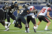 24 September 2011:  FIU safety Jonathan Cyprien (7) tackles ULL running back Aaron Spikes (20) in the second quarter as the University of Louisiana-Lafayette Ragin Cajuns defeated the FIU Golden Panthers, 36-31, at FIU Stadium in Miami, Florida.
