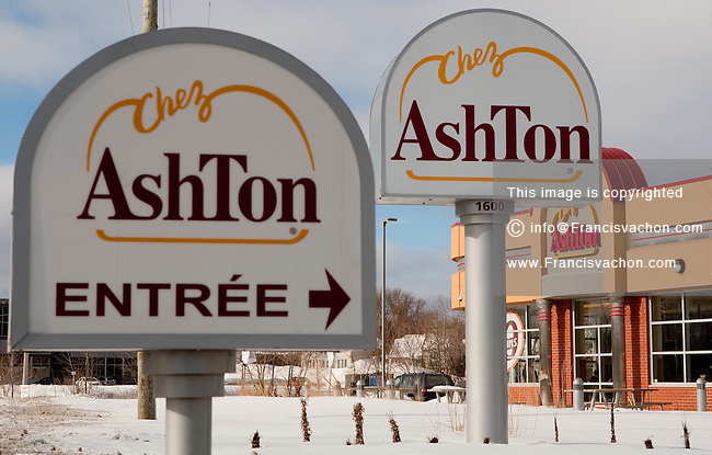 Chez Ashton restaurant signs are pictured in Quebec city January 4, 2010. Chez Ashton is a popular fast food chain in Quebec City famous for their poutine, a French Canadian dish consisting of French fries topped with fresh cheese curds and covered with hot gravy.