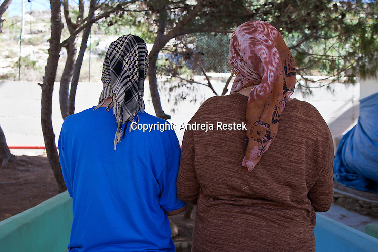 Lampedusa, two Moroccan women escaped fom Libia in the immigrant reception center waiting for decision about their future