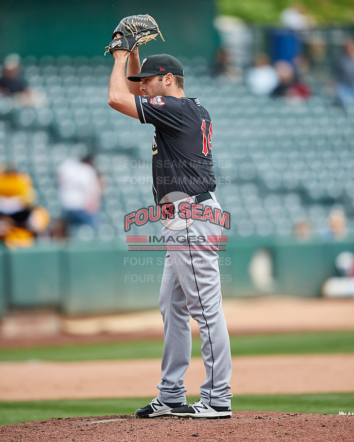 El Paso Chihuahuas starting pitcher Matt Magill (14) delivers a pitch to the plate against the Salt Lake Bees in Pacific Coast League action at Smith's Ballpark on April 30, 2017 in Salt Lake City, Utah. El Paso defeated Salt Lake 3-0.This was Game 1 of a double-header.  (Stephen Smith/Four Seam Images)