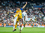 Praxitellis Vouros (c) of APOEL FC battles for the ball with Isco Alarcon (r) of Real Madrid during the UEFA Champions League 2017-18 match between Real Madrid and APOEL FC at Estadio Santiago Bernabeu on 13 September 2017 in Madrid, Spain. Photo by Diego Gonzalez / Power Sport Images