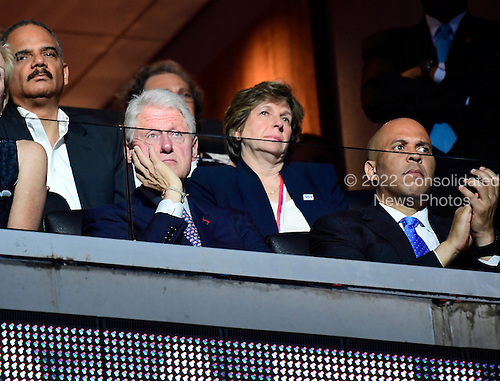 Former United States President Bill Clinton, accompanied by former US Attorney General Eric Holder, Randi Weingarten, President, American Federation of Teachers, and US Senator Cory Booker (Democrat of New Jersey) look on as US Senator Elizabeth Warren (Democrat of Massachusetts) makes remarks at the 2016 Democratic National Convention at the Wells Fargo Center in Philadelphia, Pennsylvania on Monday, July 25, 2016.<br /> Credit: Ron Sachs / CNP<br /> (RESTRICTION: NO New York or New Jersey Newspapers or newspapers within a 75 mile radius of New York City)