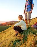 USA, California, Marin Headlands, young man and woman hikers relaxing on Mount Tamalpais