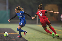 Seattle, WA - Saturday, May 14, 2016: Seattle Reign FC defender Lauren Barnes (3) tries to escape the grasp of Portland Thorns FC forward Nadia Nadim (9) during the second half. The Portland Thorns FC and the Seattle Reign FC played to a 1-1 tie during a regular season National Women's Soccer League (NWSL) match at Memorial Stadium.