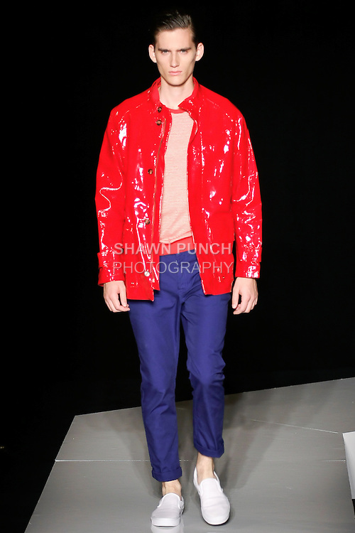 Sebastian walks runway in a red patent leather car coat, red and ivory cotton striped t-shirt, and limonge cotton five pocket pant, from the Joseph Abboud Spring Summer 2013 fashion show, during New York Fashion Week Spring 2013.