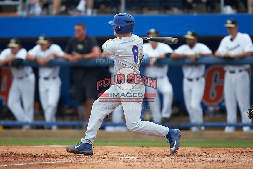 Deacon Liput (8) of the Florida Gators follows through on his swing against the Wake Forest Demon Deacons in the completion of Game Two of the Gainesville Super Regional of the 2017 College World Series at Alfred McKethan Stadium at Perry Field on June 12, 2017 in Gainesville, Florida. The Demon Deacons walked off the Gators 8-6 in 11 innings. (Brian Westerholt/Four Seam Images)