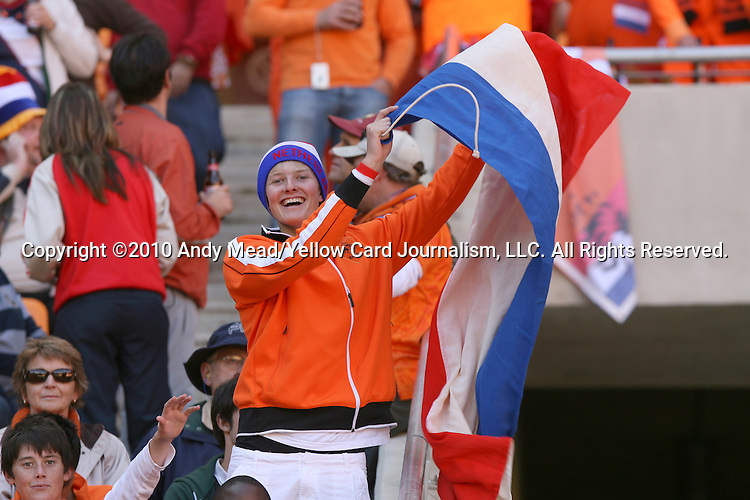 14 JUN 2010:  Dutch fan waving their national flag in the stands.  The Netherlands National Team played the Denmark National Team at Soccer City Stadium in Johannesburg, South Africa in a 2010 FIFA World Cup Group E match.