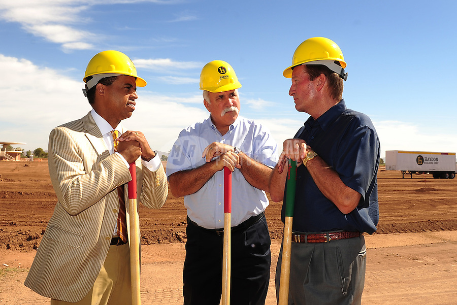 Jun. 16, 2009; Casa Grande, AZ, USA; United Football League commissioner Michael Huyghue (left) Casa Grande mayor Bob Jackson (center) and Las Vegas head coach Jim Fassel talk during the groundbreaking of the Casa Grande Training Facility & Performance Institute in Casa Grande.  Mandatory Credit: Mark J. Rebilas-