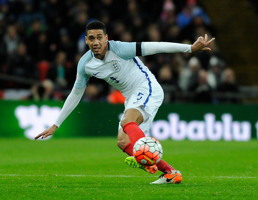 England's Chris Smalling in action during todays match  <br /> <br /> Photographer AshleyWestern/CameraSport<br /> <br /> Football - Breast Cancer Care International Friendly - England v Holland - Tuesday 29th March 2016 - Wembley Stadium - London<br /> <br /> &copy; CameraSport - 43 Linden Ave. Countesthorpe. Leicester. England. LE8 5PG - Tel: +44 (0) 116 277 4147 - admin@camerasport.com - www.camerasport.com