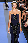 Emily walks runway in a indigo blue crepe strapless corset seamed gown with sequin panel , by Monique Lhuillier, from the Monique Lhuillier Spring 2012 collection fashion show, during Mercedes-Benz Fashion Week Spring 2012.