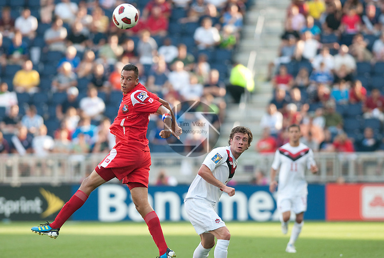 14 June 2011                        Panama attacker Blas Pérez (7, left) jumps and flicks the ball downfield in the first half.  At right is Canada midfielder Nik Ledgerwood (2).  The Panama Men's National Soccer Team played against the Canada Men's National Soccer Team in the first qualifying round of the CONCACAF Gold Cup game at Livestrong Sporting Park in Kansas City, KS on June 14, 2011.