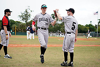 Edgewood Eagles right fielder Casey Willis (10) high fives Ryan Cassady (5) during the first game of a double header against the Bethel Wildcats on March 15, 2019 at Terry Park in Fort Myers, Florida.  Bethel defeated Edgewood 6-0.  (Mike Janes/Four Seam Images)