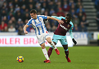 Huddersfield Town's Jonathan Hogg and West Ham United's Arthur Masuaku<br /> <br /> Photographer Rob Newell/CameraSport<br /> <br /> The Premier League - Huddersfield Town v West Ham United - Saturday 13th January 2018 - John Smith's Stadium - Huddersfield<br /> <br /> World Copyright &copy; 2018 CameraSport. All rights reserved. 43 Linden Ave. Countesthorpe. Leicester. England. LE8 5PG - Tel: +44 (0) 116 277 4147 - admin@camerasport.com - www.camerasport.com