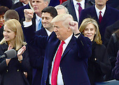 United States President Donald J. Trump acknowledges the cheers of the crowd after being sworn-in as the 45th President of the United States on the West Front of the US Capitol on Friday, January 20, 2017.<br /> Credit: Ron Sachs / CNP<br /> (RESTRICTION: NO New York or New Jersey Newspapers or newspapers within a 75 mile radius of New York City)
