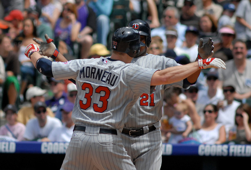 Minnesota Twins 1st baseman Justin Morneau and outfielder Delmon Young (21) celebrate a two-run homerun hit by Morneau against the Colorado Rockies. The Rockies defeated the Twins 6-2 at Coors Field in Denver, Colorado on May 18, 2008.