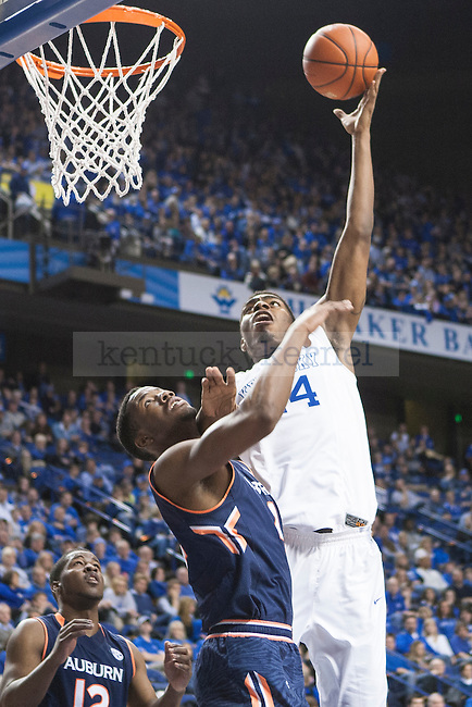 Center Dakari Johnson of the Kentucky Wildcats shoots over a defender during the game against the Auburn Tigers at Rupp Arena on Saturday, February 21, 2015 in Lexington, Ky. Kentucky defeated Auburn 110-75. Photo by Michael M Reaves | Staff.
