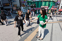 Supports hand out leaflets as Tokyo Governor, Yuriko Koike campaigns in support of candidates from her newly established Tomin First no Kai (Tokyoites First) party, in Shinjuku, Tokyo, Japan. Friday June 23rd 2017. The electioneering officially began on Friday with the popular female Governor's party fielding around 40, mostly young candidates hoping to lessen the power of the ruling Liberal Democratic Party (LDP) in the capital.