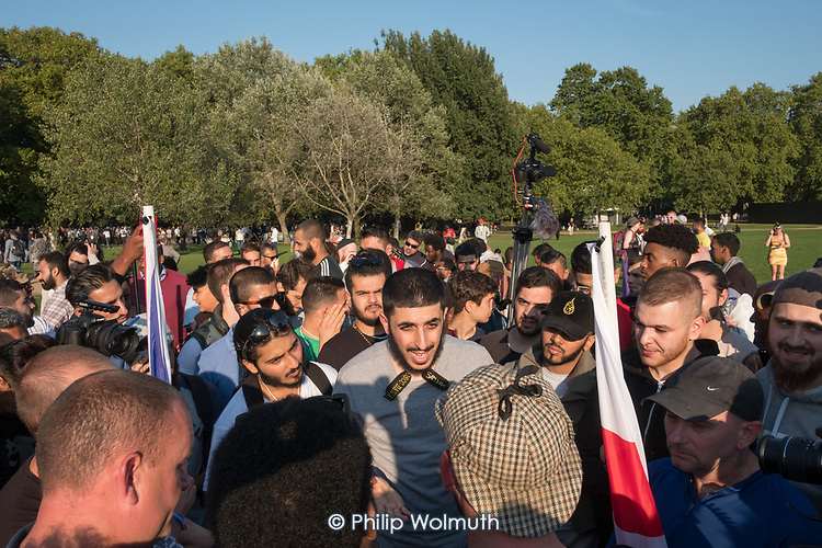 Regular Muslim debater Ali Dawah  argues with  Tommy Robinson supporters, Speakers' Corner, Hyde Park, London.