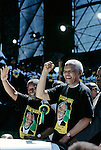 SOWETO, SOUTH AFRICA - FEBRUARY 28: President Nelson Mandela (r) and deputy president Thabo Mbeki greet followers during the start of the election campaign on February 28, 1999 in Soweto, South Africa. About 100.000 people attended the rally, and it was President Mandela's last election campaign. Mandela retired after one term in 1999 and gave the leadership to the current president Mr. Thabo Mbeki. (Photo by Per-Anders Pettersson)
