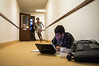 Brian Brown '16 uses the floor of a hallway in the old wing of the Mary Norton Clapp Library to study for finals, May 6, 2013. (Photo by Marc Campos, Occidental College Photographer)