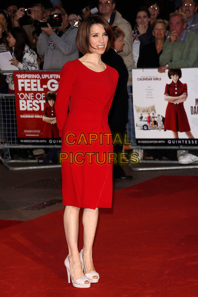 "SALLY HAWKINS.""Made In Dagenham"" UK film premiere held at the Odeon Leicester Square,  London, England, 20th September 2010..full length red long sleeve ruffle dress white open toe heels shoes peep platform pink striped .CAP/AH.©Adam Houghton/Capital Pictures."