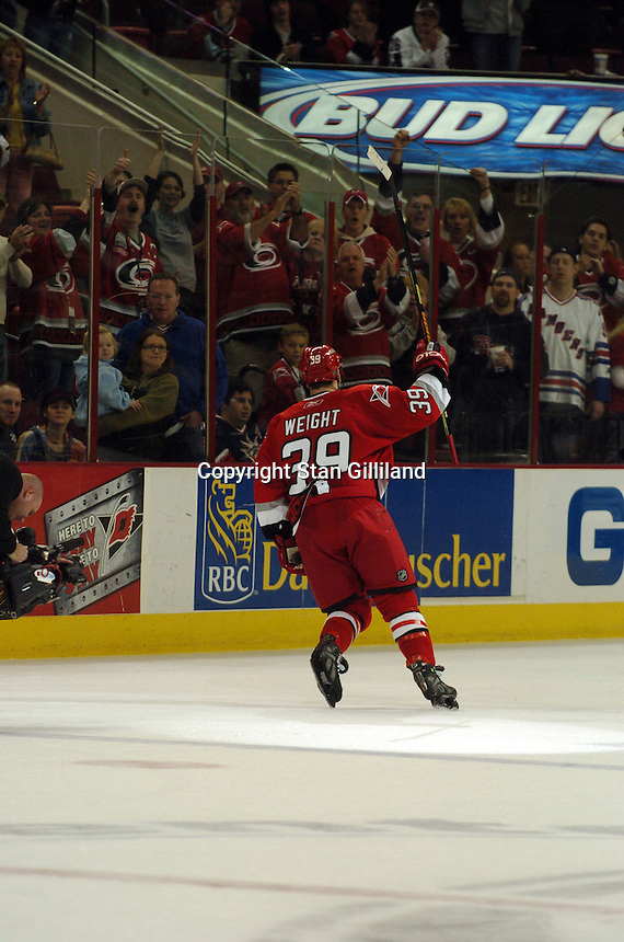 Carolina Hurricanes' Doug Weight takes a turn for the fans as the game's number one star after scoring twice against the New York Rangers Tuesday, March 14, 2006 at the RBC Center in Raleigh, NC. Carolina won 5-3.
