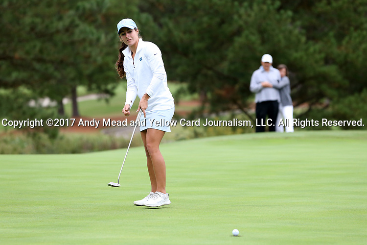 CHAPEL HILL, NC - OCTOBER 14: North Carolina's Mariana Ocano sinks a birdie putt on the 2nd green. The second round of the Ruth's Chris Tar Heel Invitational Women's Golf Tournament was held on October 14, 2017, at the UNC Finley Golf Course in Chapel Hill, NC.