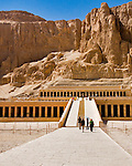 Luxor, Egypt -- The funerary temple of Hatshepsut, cut into the cliffs at the west edge of the Nile River valley at Deir el-Bahri, near the Valley of the Kings.  Hatshepsut famously was the queen who ruled Egypt as a king (male) and may have heretically had herself burried as Pharoah in the Valley of the Kings.  Subsequent pharoahs tried to obliterate evidence and monuments to Hatshepsut (beginning possibly from the reign of Thutmos III, several years after Hatshepsut's death and entombment). © Rick Collier / RickCollier.com