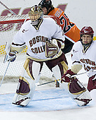 Carl Sneep 7 of Boston College helps defend the front of Cory Schneider's  1 of Boston College net while Ben Geelan 22 of Bowling Green circles around the back. The Eagles of Boston College defeated the Falcons of Bowling Green State University 5-1 on Saturday, October 21, 2006, at Kelley Rink of Conte Forum in Chestnut Hill, Massachusetts.<br />