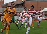 Craig Johnston clears before a challenge from Lee Erwin in the Hamilton Academical v Motherwell friendly match played at New Douglas Park, Hamilton on 24.7.12..