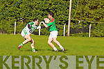 Chris Mason of Ballydonoghue tries to stop the advance of Beal's Paul Murray in the Division 4/5 play off in Ballylongford GAA grounds last Sunday