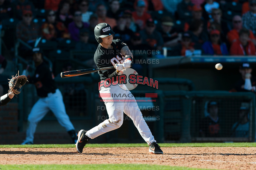 Oregon State Beavers second baseman Andy Armstrong (9) swings at a pitch during a game against the Gonzaga Bulldogs on February 16, 2019 at Surprise Stadium in Surprise, Arizona. Oregon State defeated Gonzaga 9-3. (Zachary Lucy/Four Seam Images)