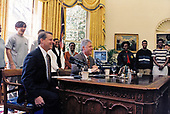 United States President Bill Clinton delivers a joint live radio address with US Vice President Al Gore in the Oval Office of the White House in Washington, DC on Saturday, April 19, 1997.  They spoke on the second national NetDay, which brings citizens from all across America together with the goal of connecting every classroom and library in the US to the internet by the year 2000.<br /> Mandatory Credit: Sharon Farmer / White House via CNP