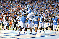 CHAPEL HILL, NC - SEPTEMBER 07: Javonte Williams #25 of the University of North Carolina celebrates his touchdown with Marcus McKethan #74 during a game between University of Miami and University of North Carolina at Kenan Memorial Stadium on September 07, 2019 in Chapel Hill, North Carolina.