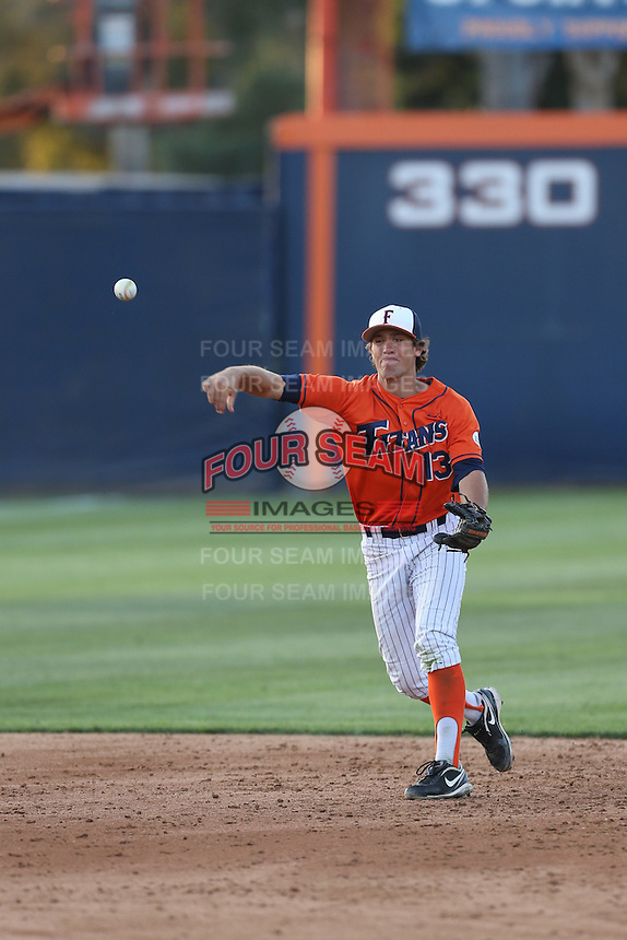 Timmy Richards (13) of the Cal State Fullerton Titans makes a throw during a game against the Cal Poly Mustangs at Goodwin Field on April 2, 2015 in Fullerton, California. Cal Poly defeated Cal State Fullerton, 5-0. (Larry Goren/Four Seam Images)