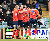 Danny Hylton of Luton Town is mobbed by team mates after scoring his sides second goal during the Sky Bet League 2 match between Yeovil Town and Luton Town at Huish Park, Yeovil, England on 4 March 2017. Photo by Liam Smith / PRiME Media Images.