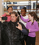 NEW YORK, NY - NOVEMBER 15:  Christopher Sieber during his 'Daddy Warbucks' hair transition with the help from the cast during the press presentation for The Holiday Return of the Broadway Hit Musical 'Annie' at the New 42nd Street Studios in New York City.  (Photo by Walter McBride/Getty Images)