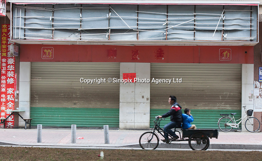 Shuttered shops are seen in Dongguan, Guangdong Province, China, 03 March 2015.