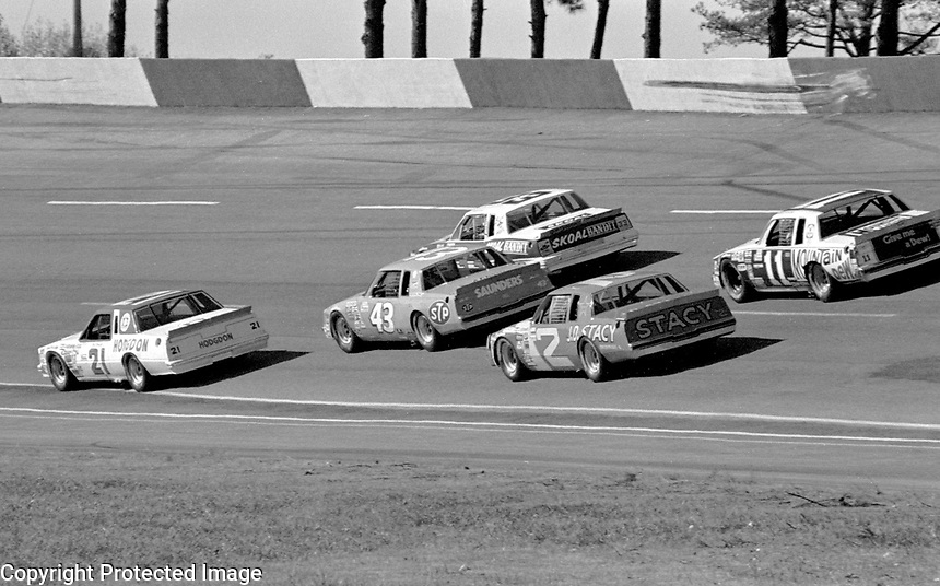 Neil Bonnett leads a pack of cars through turn three at Atlanta in November 1981. (Photo by Brian Cleary)