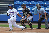 St. Lucie Mets first baseman Richard Lucas #10 at bat in front of catcher Aaron Dudley #17 and umpire Chris Tipton during a game against the Jupiter Hammerheads at Digital Domain Park on May 2, 2012 in Port St. Lucie, Florida.  St. Lucie defeated Jupiter 3-2.  (Mike Janes/Four Seam Images)