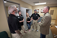 NWA Democrat-Gazette/J.T. WAMPLER Sgt.Maj. Lance Nutt, (right) talks to staff at Sheepdogs Impact Assistance Thursday April 13, 2017 in Rogers.