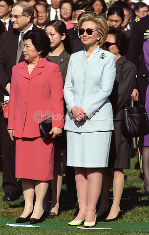 Madame Lao An, left, and U.S. first lady Hillary Rodham Clinton watch the Official Arrival Ceremony honoring Premier Zhu Rongji of the People's Republic of China at the White House in Washington, D.C. on April 8, 1999.<br /> Credit: Ron Sachs / CNP/MediaPunch
