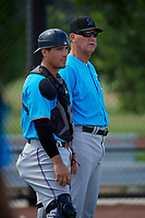 Miami Marlins coach Jamie Quirk talks with catcher Nick Fortes (7) during practice before an Instructional League game against the Washington Nationals on September 26, 2019 at FITTEAM Ballpark of The Palm Beaches in Palm Beach, Florida.  (Mike Janes/Four Seam Images)