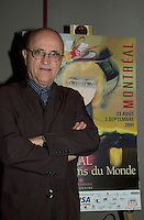 Montreal, august 6th, 2001<br /> Montreal World Film Festival's President & founder ; <br /> Serge Losique,pose for photographers beside a poster of this year Festival , August 6th, 2001 in Montreal, CANADA.<br /> <br /> This year mark the 25th anniversary of the Montreal World Film Festival<br /> Photo by Pierre Roussel / I Photo<br /> NOTE : raw jpeg from Nikon D 1, openened with QUIMAGE ICC profile
