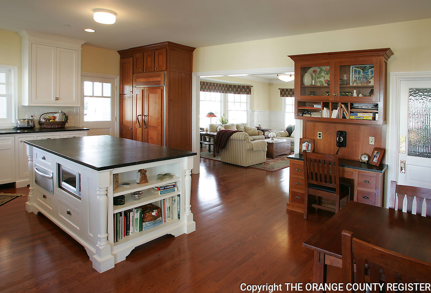 View from the kitchen area into the living room of this rebuilt Craftsman style home in Seal Beach.  The current owners demolished the original 1906 home because of many structural problems and rebuilt the house almost identical to the original.<br /> Portfolio Only