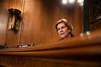 Senator Elizabeth Warren, Democrat of Massachusetts, asks the CFPB Director Kathy Kraninger a question as she testifies before the Senate Banking Committee on Capitol Hill in Washington, D.C. on March 12, 2019. Credit: Alex Edelman / CNP/AdMedia